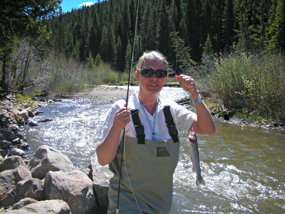 My first catch on a fly fishing adventure in Telluride, Colorado. Photo: Diana Rowe / Traveling Grandmom