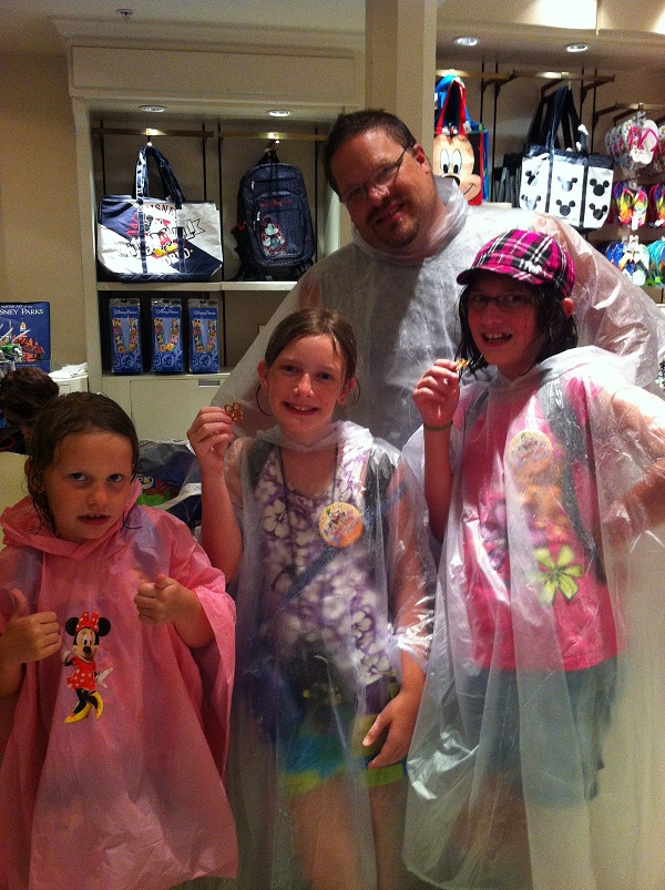 Don't forget the rain ponchos for Disney World in the rain.