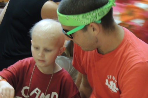 A counselor and happy camper at Boggy Creek Camp, one of Paul Newman's Hole in the Wall Camps for sick kids.