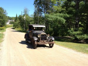 driving a model a down a country road