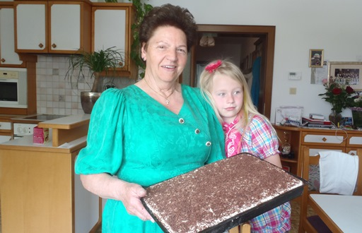 Grandmother Hermine and niece Lena show off one of their culinary creations.
