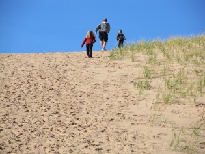 Photo by Jamie Bartosch/Suburban TravelingMom Climbing up the Sleeping Bear Dunes.