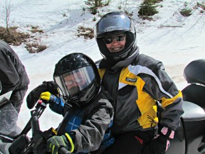 Traveling Grandmom enjoys a Sunlight Mountain Resort, Colorado snowmobile ride with her grandson
