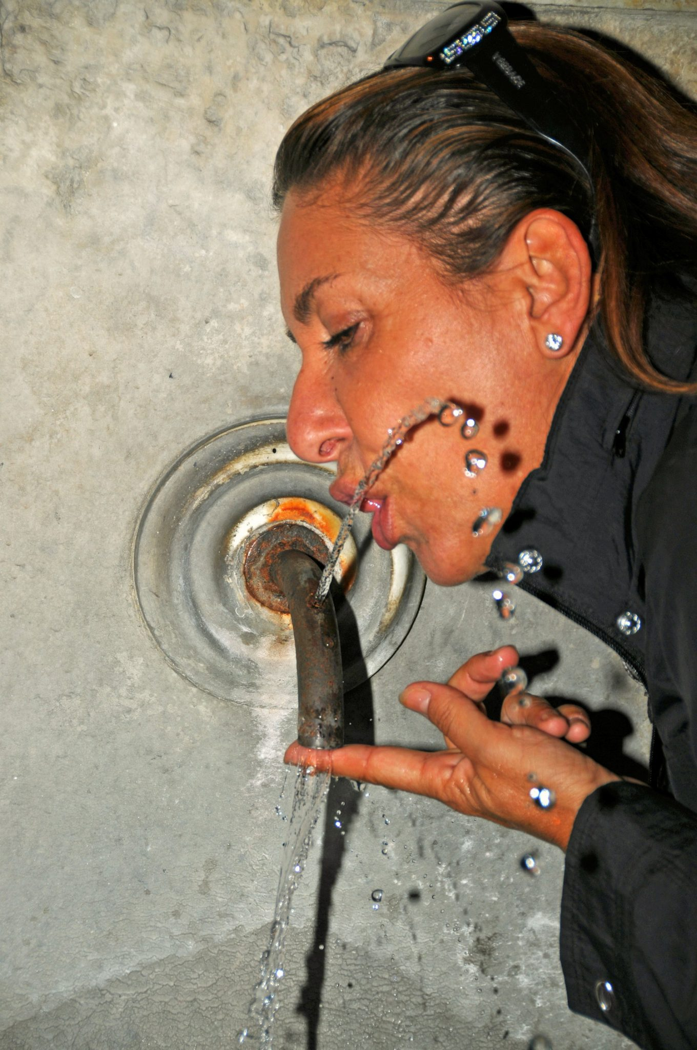A public water fountain in Italy.