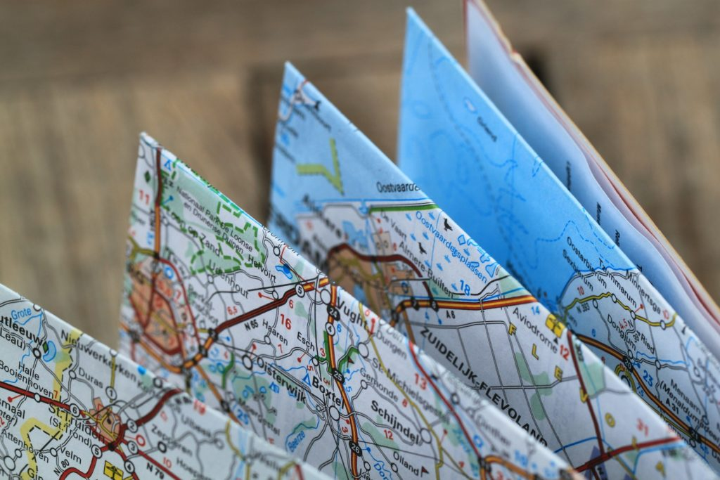 Pack a map to avoid navigation-related road trip dangers.