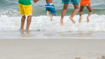 Swimming beach safety tips - go into the water as a family.