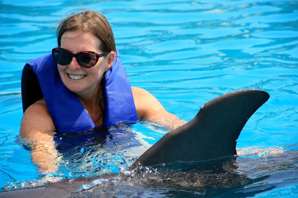 Swimming with dolphins is always fun--for adults as well as teens. Photo courtesy of Solmar Hotels.