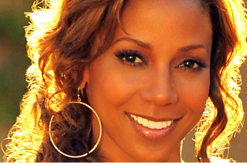 Holly Robinson Peete Talks About Children Traveling Alone and Her Must-Have Travel Items