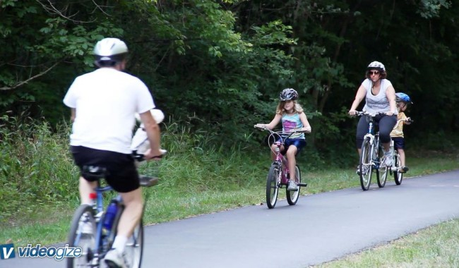 Becky and her family biking in Cape Girardeau, MO  Photo Credit: Videogize