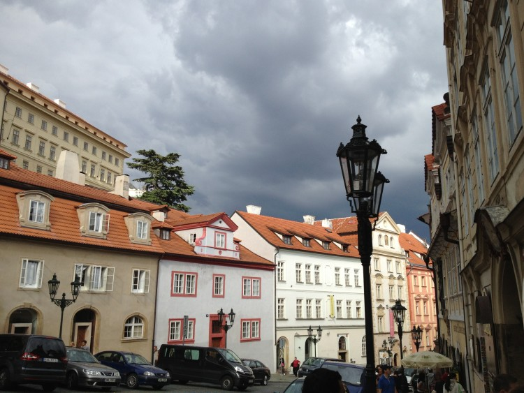 Prague street with dramatic sky