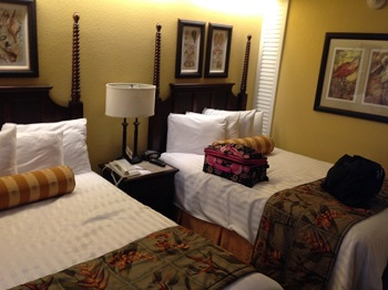 The renovation of the resort includes tropical style room decor with plush, comfortable beds. Photo credit: Scotty Reiss / Driving TravelingMom