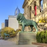 Photo courtesy of ChooseChicago.com The famous lions stand in front of the Art Institute of Chicago.