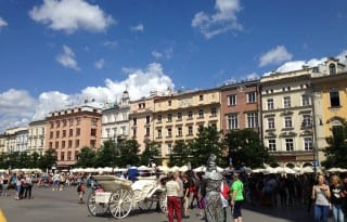 The main market square is lined with sidewalk cafes and filled with people (photo Sarah Ricks)