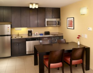 A hotel suite with a kitchen like this one from TownePlace Suites can make kids feel more at home. Photo Credit: TownePlace Suites