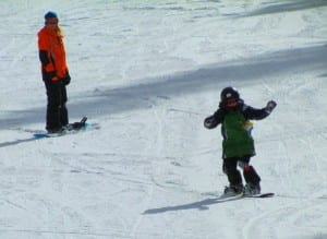 Grandson taking his first snowboarding lessons at Angel Fire Resort, New Mexico.