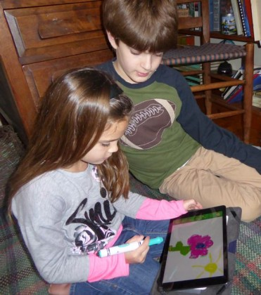 Cousins admiring drawing, and awaiting next turn. Photo by Christine Tibbetts, Blended Family TravelingMom.