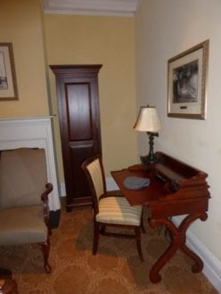 Inviting desk, tiny closet, comfy chair in Jekyll Island ClbHotel guest room. Photo by Christine Tibbetts, Blended Family TravelingMom