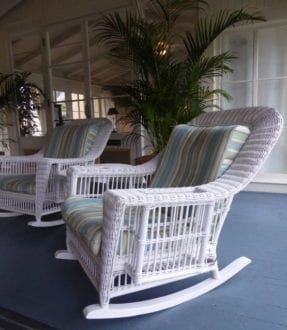 White wicker invites rocking at Jekyll Island Club Hotel. Photo by Christine Tibbetts, Blended Family TravelingMom