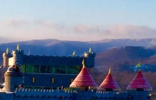 Smoky Mountains beyond castle towers are the view from The Inn at Christmas Place. Photo by Christine Tibbetts, Blended Family TravelingMom