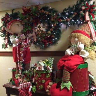 Christmas elves and many Santas decorate the Inn. Photo by Christine Tibbetts, Blended Family TravelingMom