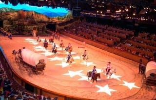 Video mapping and LED lights transform Dolly Parton's Dixie Stampede performance arena.