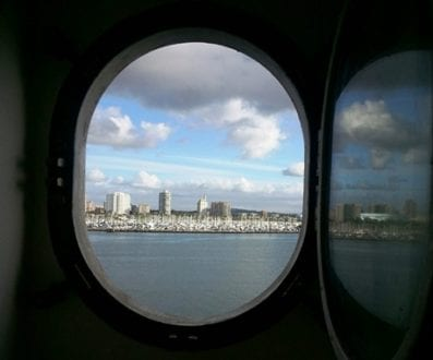 A view of downtown Long Beach from the stateroom's porthole window. Photo credit: Gwen Kleist, Healthy TravelingMom