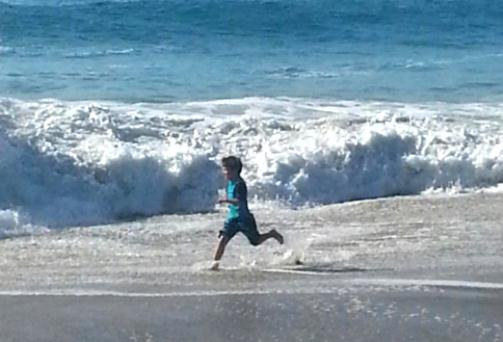 Playing on the beach is the #1 San Diego fun & free experience! Photo credit: Gwen Kleist, Healthy TravelingMom