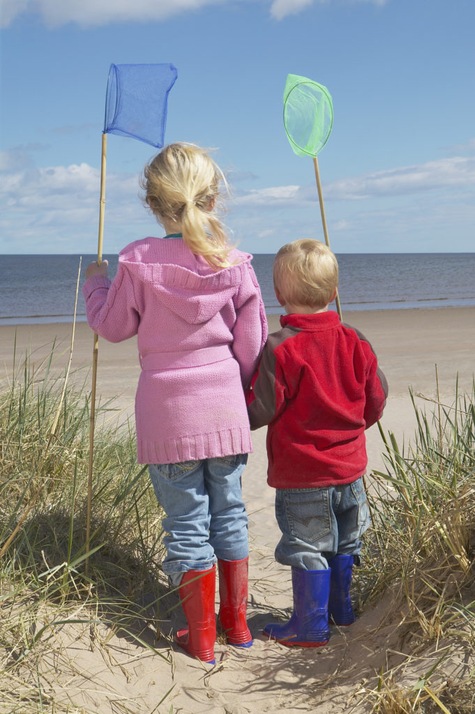 Two kids with fishing nets.