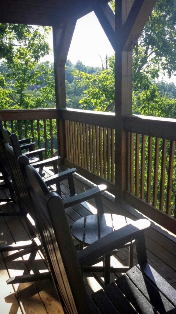 Mountain cabins often offer simple luxuries like rocking chairs.