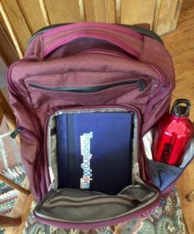 Leave tablet and laptop in defined spaces that airport security can see. Photo by Christine Tibbetts, Blended Family TravelingMom.
