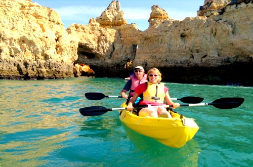 Kayaking through spectacular caves in Lagos Spain.