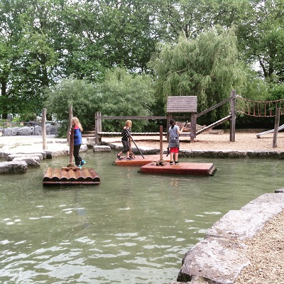 Kids steer actual wooden rafts on Mainau Island