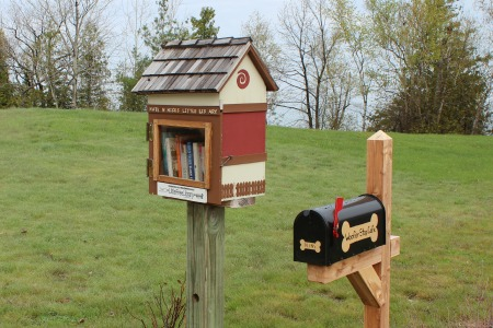 The Little Library and Woofer Stop Cafe located along the Little Traverse Wheelway in Petoskey, Michigan.
