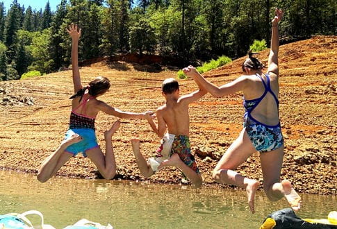 Photo Credit: Carissa Rogers -- her kids 'jumping' into summer.