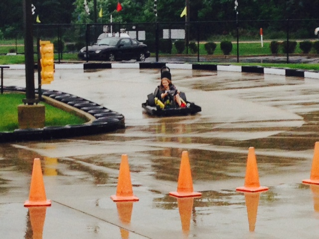 Photo by Jamie Bartosch/Suburban TravelingMom Go-karting in the 57-degree rain in June at Sugar Grove Family Fun Center in Yorkville, Illinois.