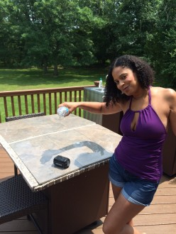 Kamryn Adams/LifeCoach Travelingmom testing the Philips Shoqbox for true water resistance.