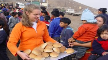 Sondra helping at a feeding program in Peru