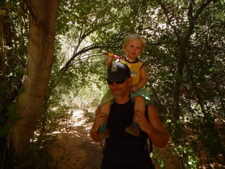Hiking with daddy ... much of this hike feels like a rain forest in the middle of the desert!