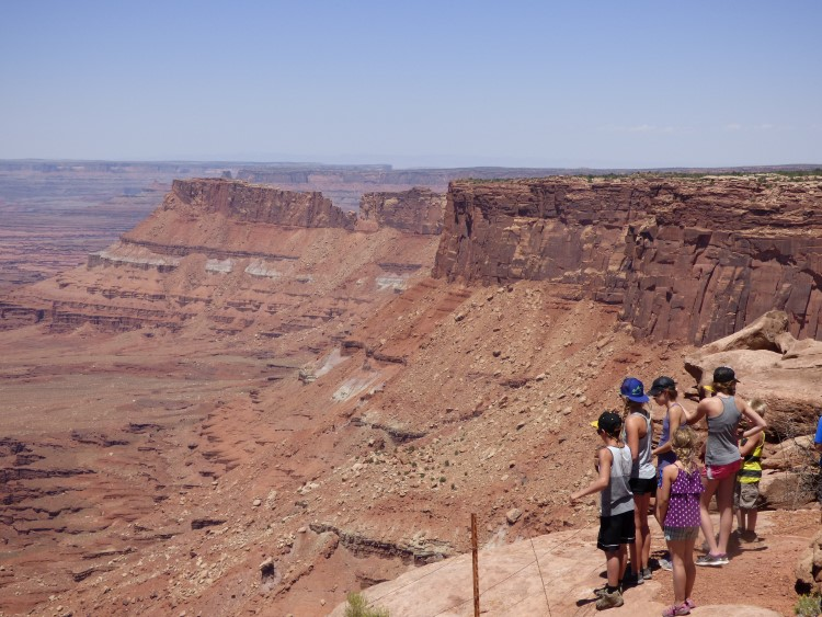 The family exploring Canyonlands! Breathtaking beauty! You feel super small!