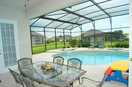 Beautiful and relaxing pool and lanai leading out to a spacious backyard for fun! Photo Credit - Heidi LaDuca