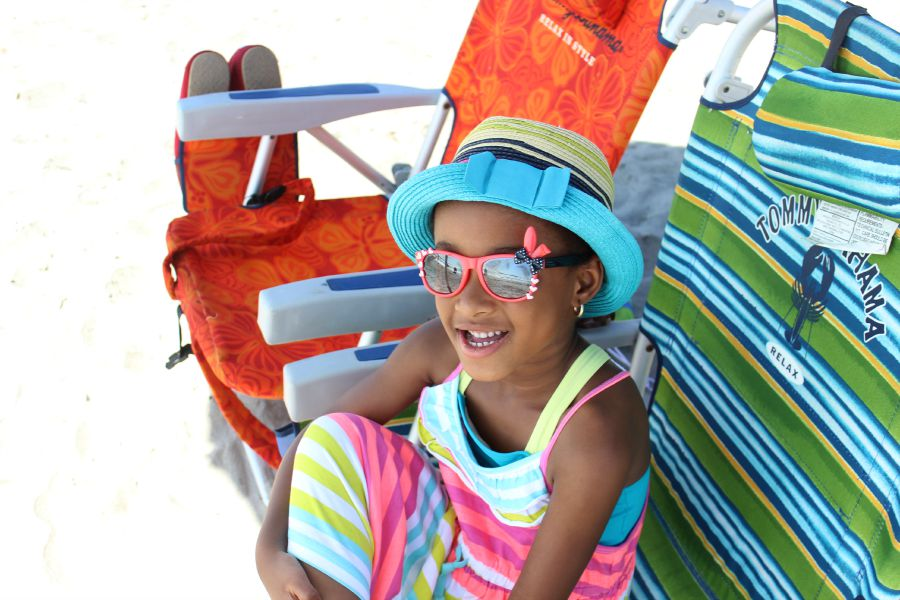 sun protection is just one essential to bring to the beach with young kids