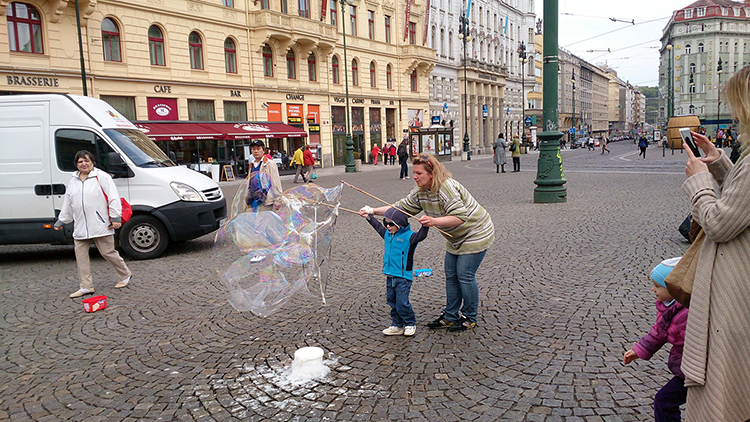 Blowing bubbles is one of the fun things to do in Prague with kids.