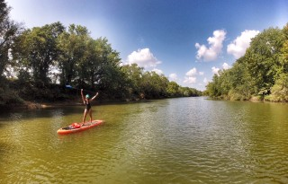 Choose a calm lake for a first paddle on your SUP adventure.
