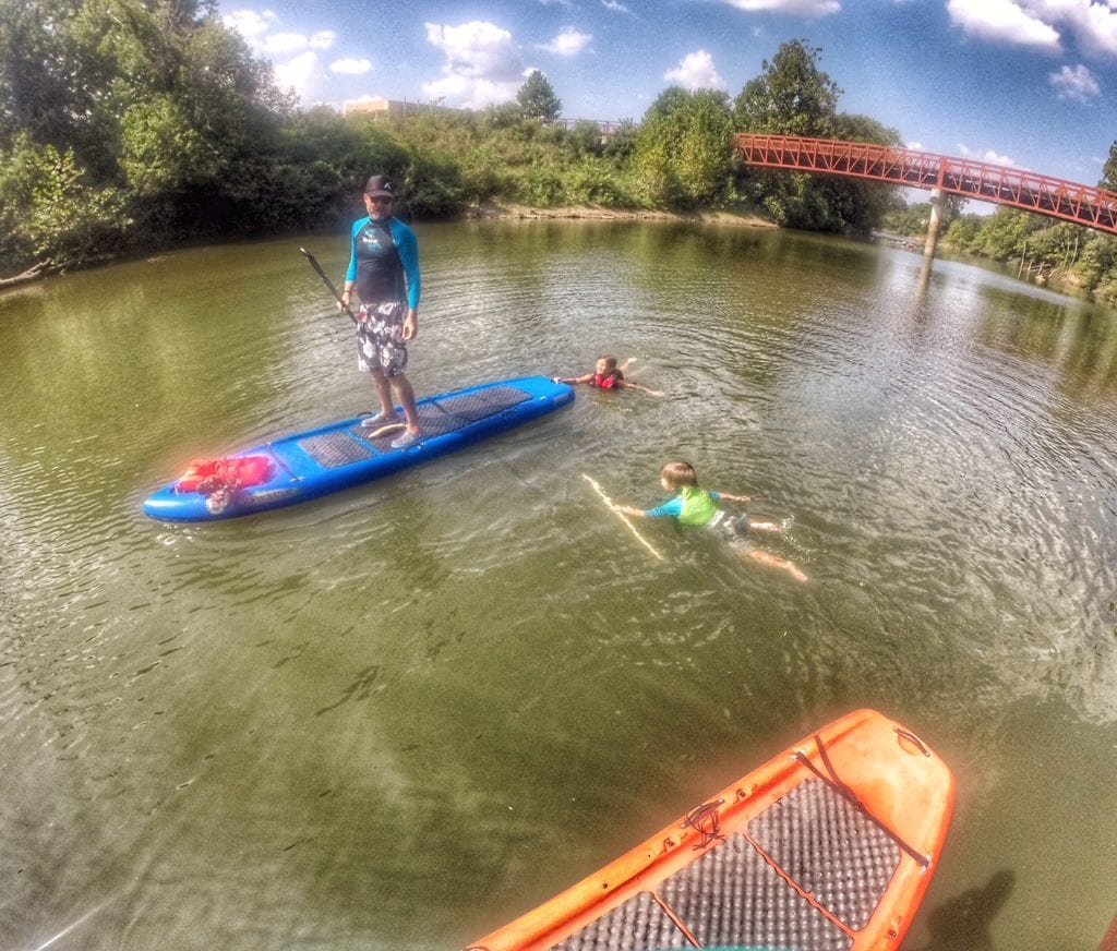 Kids paddle in and on the water