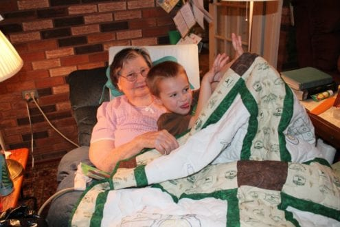 Handmade Keepsakes are cherished forever. My son and his Great Grandma on Christmas 2011 - he sleeps with that quilt every night. Photo Credit: Becky Davenport