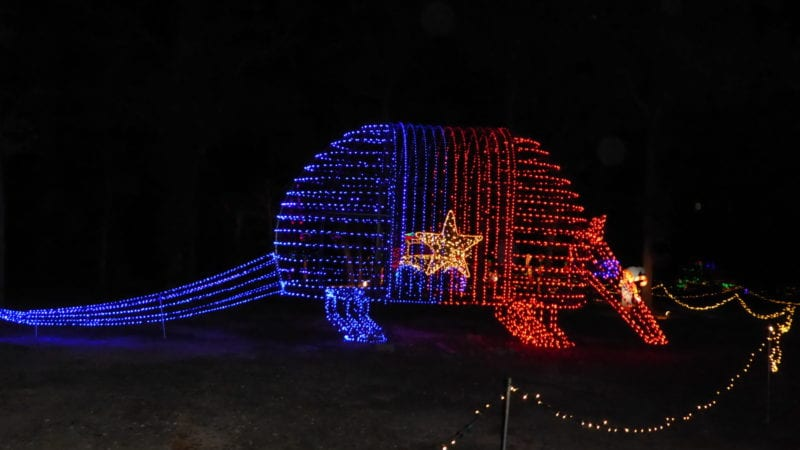 red and blue light display of armadillo with Texas star on it located at Santa's Wonderland in Bryan-College Station Texas