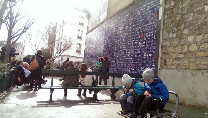 Boys hjaving fun by the 'Je t'aime' wall in Montmartre in Paris.