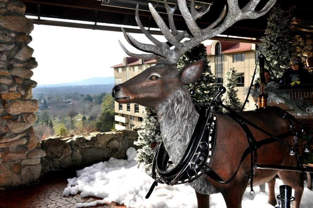What makes the Omni Grove Park Inn the best Christmas hotel in Asheville? A photo opportunity worthy area with a reindeer and sleigh on the Sunset Terrace.