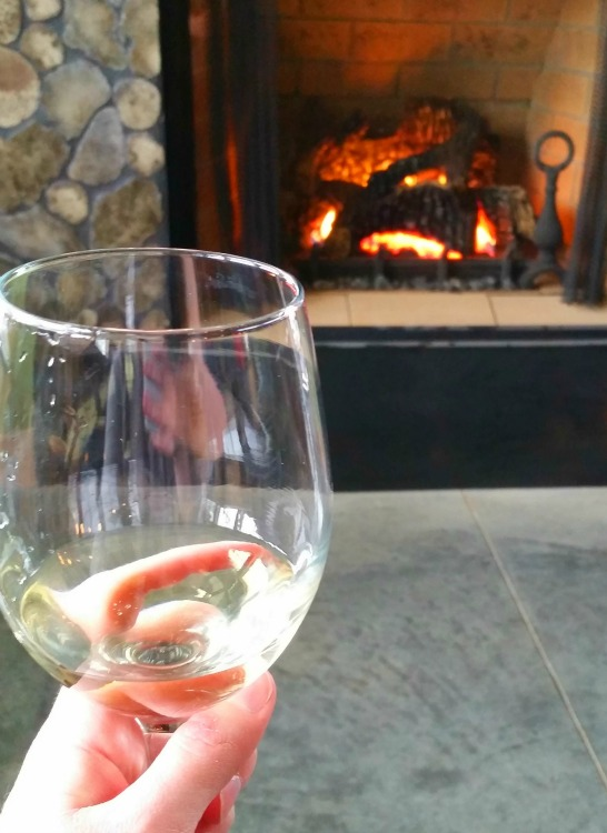 Sipping Wine Fireside at Cogdal Winery in South Haven. Photo by Mary Moore / Retro TravelingMom