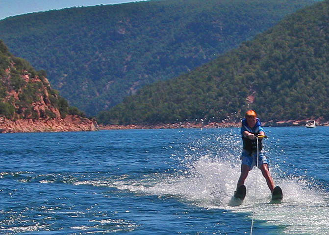 Flaming Gorge NRA, son Daniel waterskiing - photo by Yvonne Jasinski Credit Card Traveling Mom